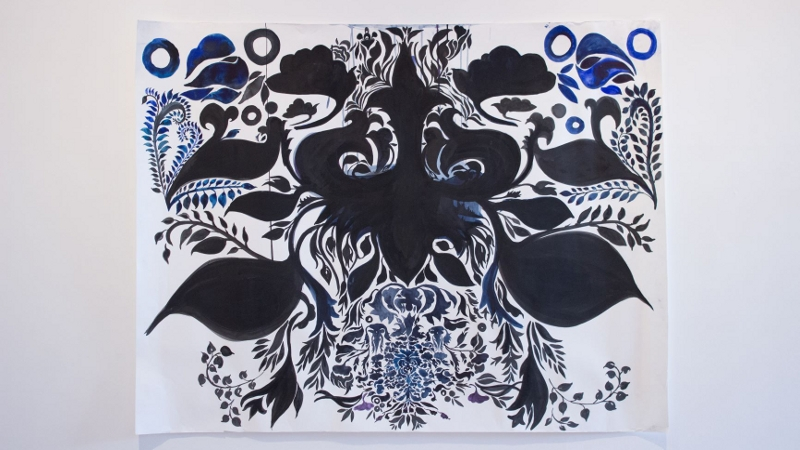 A decorative floral pattern in shades of dark and light blue.