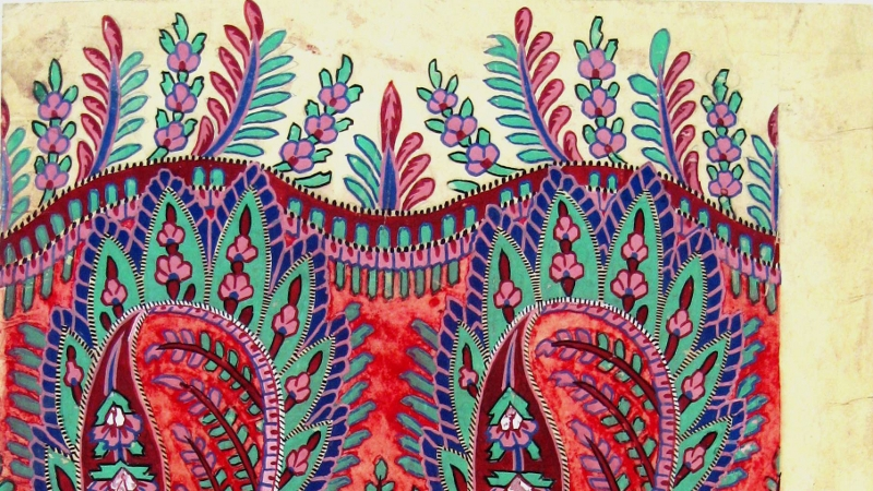 A close up image of a detailed paisley pattern, with bright green, red, pink and purple colours.